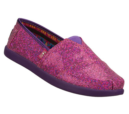 She'll look great and feel happy to help other kids wearing the SKECHERS Bobs World shoe.  Sparkling glitter fabric upper in a slip on casual flat with stitching and overlay accents. - $35.00