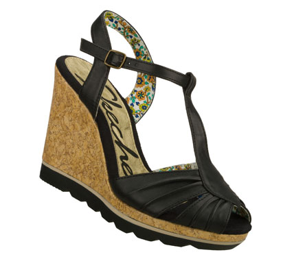 Entertainment Be on the forefront of fashion with the SKECHERS Cali Cutting Edge sandal.  Smooth metallic or matte faux leather upper in a t-strap sandal with cork wedge heel. - $45.00