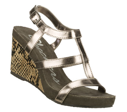 Entertainment Put some bite into your warm weather style with the SKECHERS Modiste - Venom sandal.  Shiny metallic or matte finish faux leather upper in a strappy dress sandal with snake textured wedge heel. - $55.00