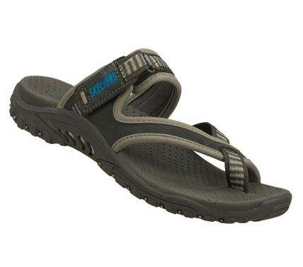 Surf Beach style and comfort is in the SKECHERS Reggae-Rasta sandal. Soft nubuck and web fabric upper cross strap thong sandal with an adjustable slide strap for added comfort. - $49.00