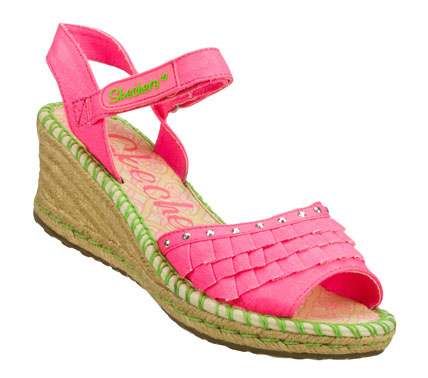 Entertainment Fun summery fashion she'll love to wear comes in the SKECHERS Cali Tikis - Ruffle Ups sandal.  Soft fabric upper in a wedge heeled ankle strap dress casual espadrille slide sandal with stitching accents; sequin detail and fun ruffles. - $33.00