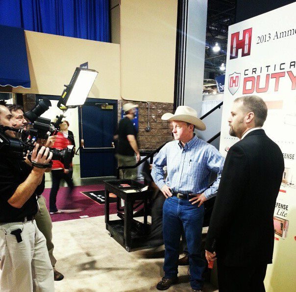 NAH TV crew shooting with Mark Kayser at the Hornady booth.