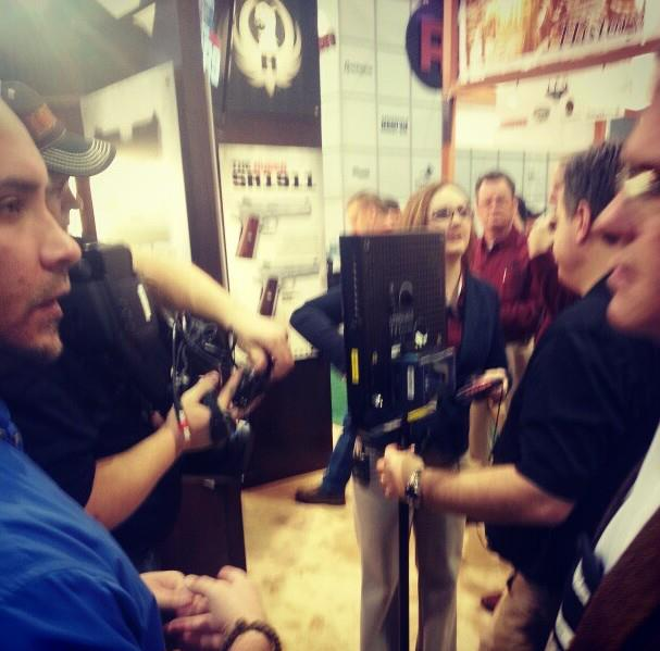 Luke's doing his best to not break the camera lens. Video shoot at the @RugeRuger booth. #shotshow