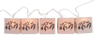 Camp and Hike Illuminate your den, deck or patio with the soft ambience that a set of paper-shaded lights can bring. Each strand features five, pattern-decorated, 3 cubes with mini bulbs. Available: Tree, Mountain. - $19.88