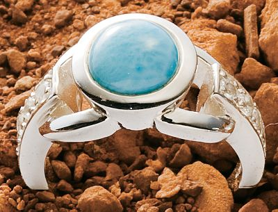 Entertainment Beautifully set, Caribbean-sea-blue larimar is accented with sparkling white topaz and highly polished sterling silver. Heat and pressure from volcanic lava flows crystallized larimar gemstones eons ago, and they went largely undiscovered until 1974 when a Peace Corps volunteer stumbled across a deposit of the brilliant blue stone along a remote Caribbean seashore. Now it's treasured for its rich blue hues and one-of-a-kind look. This ring has a sterling silver ring shank studded with white topaz and set with a round larimar gemstone.Whole sizes: 6-9. - $144.00