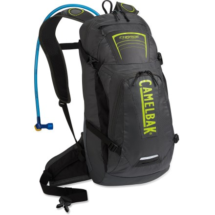 MTB An ultralight performer, the CamelBak Charge hydration pack is ready for mountain bike endurance races or epic adventures. 100 fl. oz. Antidote(TM) reservoir is equipped with the Quick Link(TM) connection system for hassle-free removal of the drinking tube. Big Bite(TM) valve is ergonomically positioned for easy drinking. Back panel uses Lightweight Exoskeleton(TM) design with molded EVA foam wrapped in mesh fabric to create lightweight support and great airflow. Easily access the reservoir via the dedicated, zippered panel at the back. The Charge is constructed out of ultralight materials throughout; Durable Water Repellent finish helps fend off light rain. Holds 701 cu. in. of gear, plenty of space for all of your riding needs; 4-point adjustable harness offers a custom, secure fit. Zippered external top pocket includes an MP3 player holder; zippered lower pocket with a key clip and mesh organizer holds cycling essentials. Adjustable overflow storage between the pack and the outer pocket can hold a jacket or be rigged to carry an XC cycling helmet. Hipbelt pockets with elastic closures offer accessible storage for small items such as energy bars or gels. CamelBak Charge hydration pack has reflective detailing, increasing your visibility in low light. Designed to carry a helmet, multitool, CO2 pump & cartridges, spare tube, extra layer, energy foods, MP3 player, cell phone, wallet and keys. Closeout. - $79.73