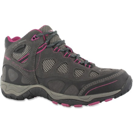 Camp and Hike Tackle new trails in the women's Hi-Tec Total Terrain Mid WP hiking boots that feature waterproof protection along with sturdy construction and support. Waterproof, seam-sealed suede leather uppers offer durability; breathable nylon mesh underlays improve ventilation. Boots feature waterproof breathable membranes to keep feet dry and comfortable. Padded collars protect ankles; nylon linings wick moisture away from feet for additional comfort. Gusseted tongues keep out debris; heel loops aid entry. Removable EVA insoles and compression-molded EVA midsoles deliver cushioning and support for long treks. Steel shanks supply additional support and stability underfoot. Carbon rubber outsoles on the Hi-Tec Total Terrain Mid WP hiking boots have self-cleaning lugs and offer solid traction on uneven ground. Closeout. - $44.93