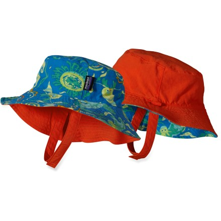 The Patagonia Reversible Baby Sun bucket hat can be worn with the print showing or the solid color showing. Either way, this adorable hat has a wide brim to protect young skin from the sun. - $19.93