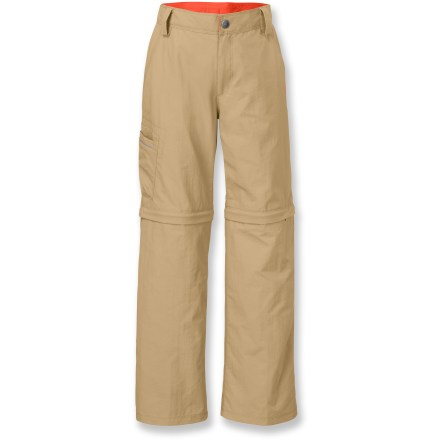 Camp and Hike The Voyance Convertible pants by The North Face come equipped with features that let boys play, travel, hike, camp and do pretty much anything from dawn to dusk while feeling totally comfortable. Pant legs zip off into shorts so he can switch when he gets too warm on the trail. Lightweight and quick-drying, ripstop nylon stands up to weather, abrasion and a few grass stains with no problem. Nylon fabric is also treated with a Durable Water Repellent finish that helps water bead up and roll off. For days when the sun outshines the rain, the fabric features UPF 50+ sun protection that continuously guards against harmful ultraviolet rays. Internal elasticized waistband is adjustable; zip fly and belt loops add a finished look. Front slash hand pockets provide easy storage; 2 rear pockets with flap closure and 1 side cargo pocket have room for small valuables. Reflective piping at cargo pocket promotes visibility. EZ Grow hem function offers extra fabric that can be let out at the seams to allow for growth spurts. - $30.93