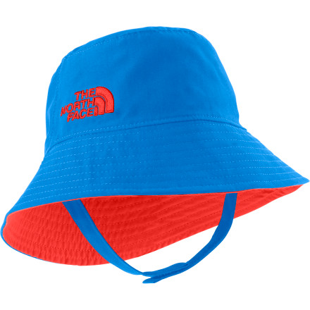 Keep sunny days happy days once you cover your youngin's head with The North Face Baby Sun Bucket Hat. This reversible cap blocks out the UV rays before they scorch his or her head, and the hook-and-loop chin strap keeps the hat secure during beautiful ocean breezes. - $19.95