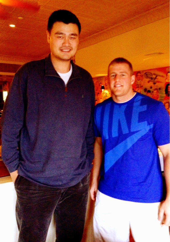 Sports - The NFL's Defensive Player of the Year, JJ Watt (6'5″, 295 LBS), beside Yao Ming