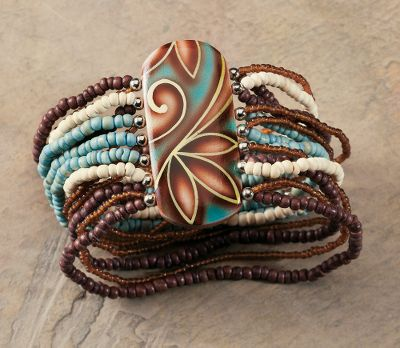 Entertainment Multiple stretchable strands, genuine turquoise, coco beads, silver metal beads and a hand-painted centerpiece deliver the eye-catching impact youre looking for. Dimensions: 7-1/2L x 2W. Color: Turquoise. Gender: Female. Age Group: Adult. - $18.39