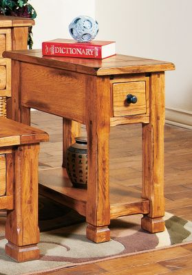 Entertainment The rustic, yet sophisticated appeal of the Sedona Chairside Table lingers in the details. The inviting piece is crafted of solid oak and oak veneer construction. The prized woods natural beauty is highlighted with a warm, inviting glow of a distressed oak finish. Dented old-time pull handles and drawers with full-extension, ball-bearing drawer slides for years of smooth and dependable motion. Designed with old-fashioned charm, this table will easily blend with any dcor. Dimensions: 25L x 15W x 27H. Weight: 52 lbs. Color: Natural. - $340.99