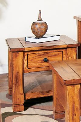 Entertainment The rustic, yet sophisticated appeal of the Sedona End Table lingers in the details. The inviting piece is crafted of solid oak and oak veneer construction. The prized woods natural beauty is highlighted with a warm, inviting glow of a distressed oak finish. Dented, old-time pull handles and drawers with full-extension, ball-bearing drawer slides for years of smooth and dependable motion. Designed with old-fashioned charm, this table will easily blend with any dcor. Dimensions: 24L x 26W x 22H. Weight: 74 lbs. Color: Natural. - $445.99