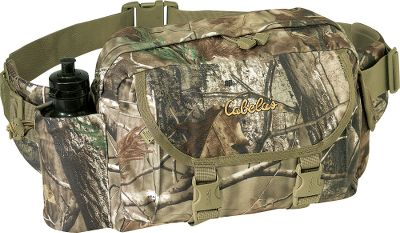 "Hunting Our Deluxe Whitetail Packs offer superior hunting performance. They are constructed of durable, ultrasoft CT450 Plus for silence in any condition. This Cabela's-exclusive fabric's shell is finished with waterproof coating and lined with a waterproof-rated puncture-resistant fabric. Heavy-duty zippers have cord pulls instead of noisy metal tabs. The molded-foam back creates an extra measure of support and comfort. Reinforced stitching at all stress points. An internal organization panel keeps small items in order. Includes Buddy-Lok attaching system. The Fanny Pack has a large main compartment that measures 12""W x 9-1/2""H x 4-1/2""D, with an outside zippered 8"" x 9"" flat map pocket. It has a cinch-top water bottle pocket (a 20-ounce bottle is included). Lash straps secure a jacket or raingear, and the padded hip belt offers extra comfort. Buddy-Lok system compatible. Have your most-needed gear items within easy reach and ready to use with the Buddy-Lok system. To attach one or more of the accessory pouches (sold separately) to your pack, simply interlock the male end of the Buddy-Lok accessory to the female end on the pack and twist 90 degrees.Imported.Capacity: 650 cubic. inch.Camo patterns: Realtree AP HD , Mossy Oak Break-Up, Blaze Orange, Seclusion 3D . - $29.88"
