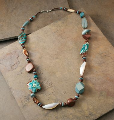 Entertainment Adorn yourself with the smooth look and feel of authentic turquoise, hand-painted floral beads and handcrafted coco wood. Floral beads are made of a nickel-free silver base with a white shell and the chunky single strand is wax cord. Lobster claw fastener.Chain length: 15. Type: Necklaces. - $26.88