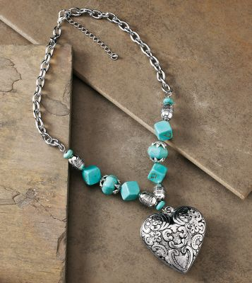 Entertainment Stunning, elegant and ready to make the right impression. Cast-metal silver heart pendant boasts fantastic scroll and flower designs. Simulated turquoise stones and silver-colored beads on a chain-link necklace complete its stunning effect. Nickel-free.Pendant dimensions: 2L x 1-3/4W.Chain length: 18 with 3 extension. - $26.88