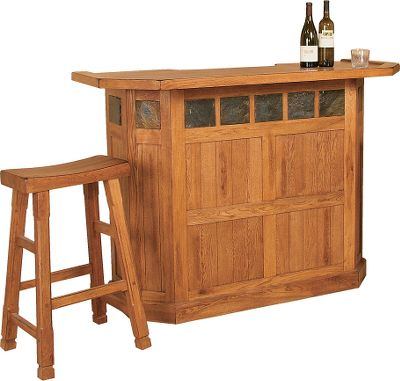 Entertainment Constructed of distressed oak and veneers and accented with stone slates, this stand-alone Sedona Bar is the perfect addition to any rustic home, cabin or office. Its inviting shape makes it easy to pull a stool up to, and the 42 height makes hosting easy. Two drawers with smooth dovetail joints and full-extension ball bearings feature dented country-style knobs. Three racks can accommodate up to 15 bottles and stemware can be stored on hanging racks. A cabinet under each drawer allows for even more storage. Stools sold separately. Backless stool unavailable. 42H x 60W x 24D. Color: Oak. - $1,195.99