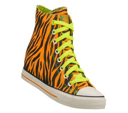 Entertainment Go on the prowl in cool style with the Daddy'$ Money: Gimme - Wicked shoe.  Animal print woven soft canvas fabric upper in a lace up classic casual high top sneaker with hidden 2 inch wedge heel. - $60.00