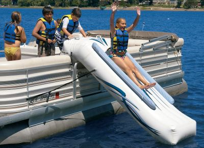 Wake A rugged, commercial-grade slide that provides hours of fun on the water and makes any pontoon ride a blast for kids and adults. Features a 9-ft.-long slick sliding surface, two center-slider-centering air chambers, four inset-molded footsteps and two molded-vinyl assist handles. Includes a 12-volt high-pressure inflator/deflator. Rolls up to the size of a sleeping bag. One user at a time.Maximum weight capacity: 200 lbs.Dimensions: 10L x 211W x 58H.Weight: 30 lbs. Type: Personal Watercraft Accessories. - $499.99