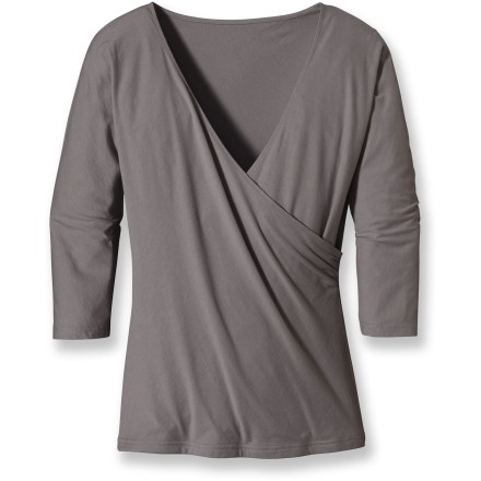 As a top that adds a lot to your wardrobe, the Patagonia Green Gardens Wrap top can be dressed up for a night out or dressed down for a real casual look. Organic cotton/Tencel(R) lyocell blend is supersoft and breathable. V-neck; 3/4-sleeves. The Patagonia Green Gardens Wrap top falls at the hips. Closeout. - $39.93