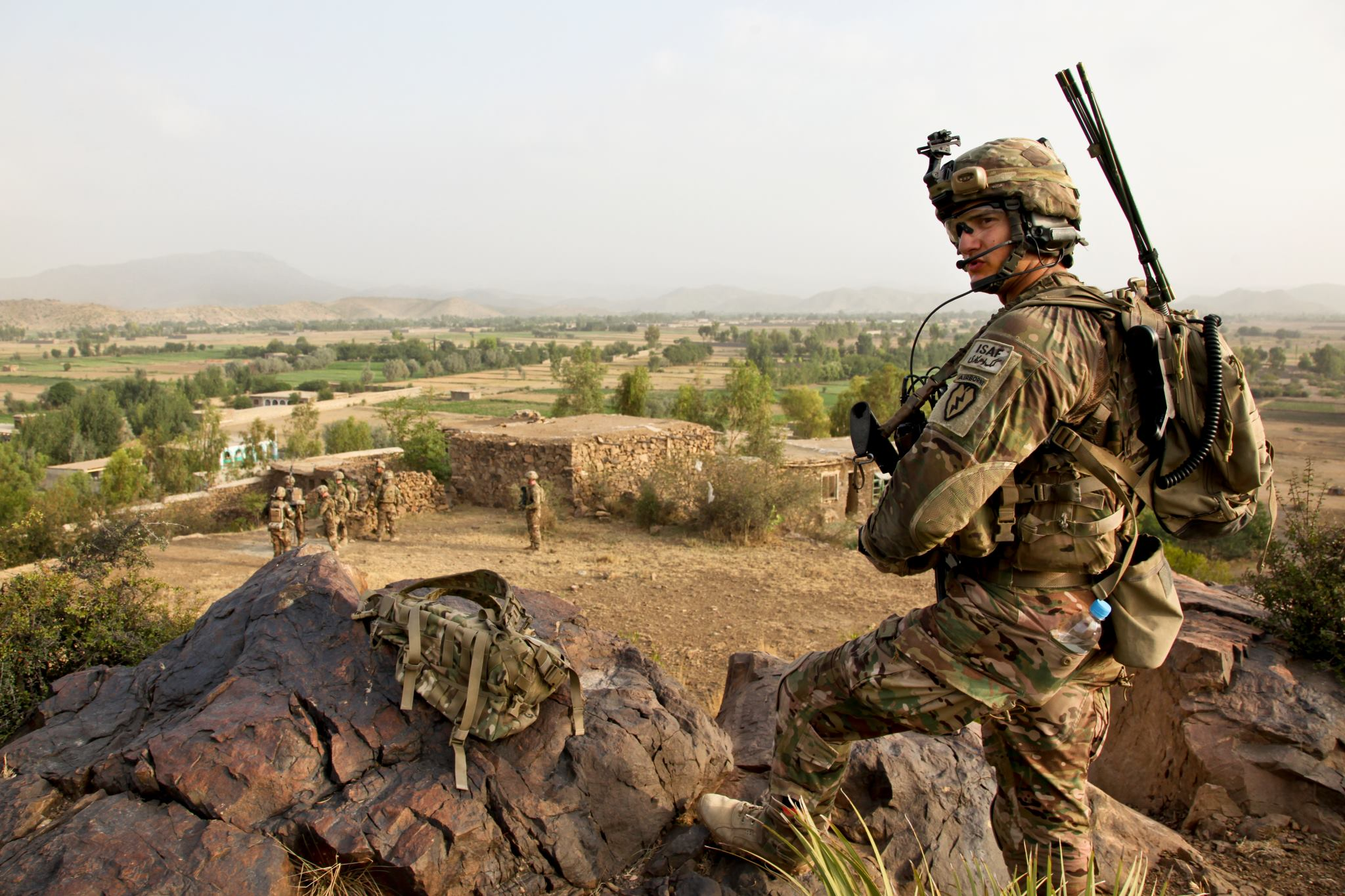 Guns and Military U.S. Army Spc. Jordan Duffy, a forward observer assigned to 1st Battalion (Airborne), 501st Infantry Regiment, 4th Brigade Combat Team (Airborne), 25th Infantry Division, provides security from the top of a hill in Afghanistan, July 31.