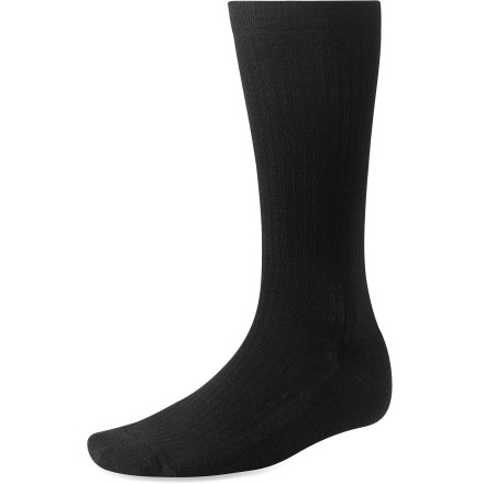 The Standup Graduated Compression socks from SmartWool are perfect for business travelers and those on their feet all day. Mild compression soothes and minimizes ankle, leg and foot swelling while reducing fatigue. Low-volume micro cushioning provides just enough impact absorption and while still fitting well in everyday shoes. 15-20 mmHG Graduated compression throughout. Soft, low-pressure tops ensure a nonbinding fit; buried toe closures reduce abrasion. Made from soft merino wool blended with nylon, these socks wick moisture away from your feet, keeping them dry and cool in summer and warm in winter. Merino wool is naturally odor resistant. SmartWool socks are guaranteed not to itch and can be repeatedly machine washed and dried without shrinking. *Discount will be applied when you check out. Offer not valid for sale-price items ending in $._3 or $._9. - $17.93