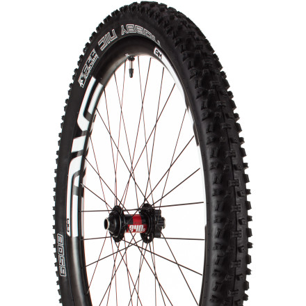 "MTB Bikes designed with the 27.5in standard are intended for just about any kind of riding. And, that's just what Schwalbe Nobby Nic TL Ready Snakeskin tire is intended for too. From XC marathons to backcountry adventures, this mid-wheel sized tire excels. It's an ideal tire for rough conditions -- wet or dry. It uses Schwalbe's Pacestar Triple Compound rubber to optimize the tire's performance wherever possible with regards to grip, durability, and rolling resistance. The knobby tread provides excellent traction in all conditions, and its cornering is outstanding thanks in part to the soft rubber compound and the U-shaped shoulder blocks. They're angled about 20 degrees towards the outside of the tire, with siping that doesn't quite divide the block, creating the ""U"". These siped U-Blocks deform easily and mold over the trail surface, working to counteract the lateral forces when you're cornering hard. It also has what Schwalbe calls, ""phase shifted blocks"". The simple explanation is that the tread blocks across the casing are not all in an even spacing pattern. Instead, the lateral clusters of blocks alternate from more closely spaced to more widely spaced. What they found was an oscillation that developed within the old version of this tire at certain speeds -- This latest version uses the phase shifted blocks to eliminate the dissonant vibration. The tire is designed to be tubeless ready (TL), which means you can say goodbye to pinch flats. A tubeless system allows you to run less air pressure, again enhancing the grip of the tire's tread. Better traction, less vibration, and no flats lead to a great ride. It's necessary to use a liquid sealant within the tire to get an initial seal against the rim. The sealant will also work to seal thorn or debris punctures as you ride. The Snakeskin protection is a layer of abrasion resistant fabric mesh that's embedded into the outer layer of the casing on the sidewall. - $89.95"