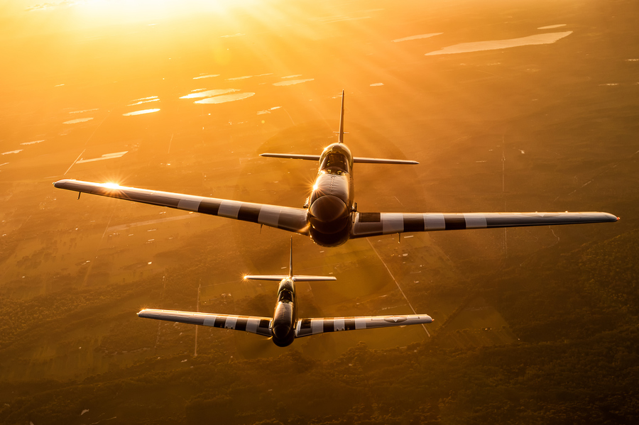Guns and Military Stallion 51's TF-51 (dual seat/dual control P-51D) Mustangs out for a sunset stroll over central Florida