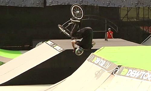 BMX Harry Main - hop flip into the box landing at Dew Tour.