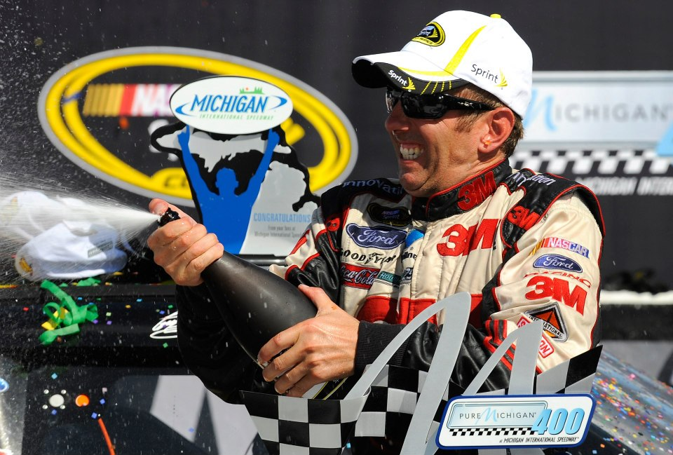 Motorsports Greg Biffle, driver of the #16 3M Ford, celebrates in Victory Lane after winning the NASCAR Sprint Cup Series Pure Michigan 400 at Michigan International Speedway on August 19, 2012