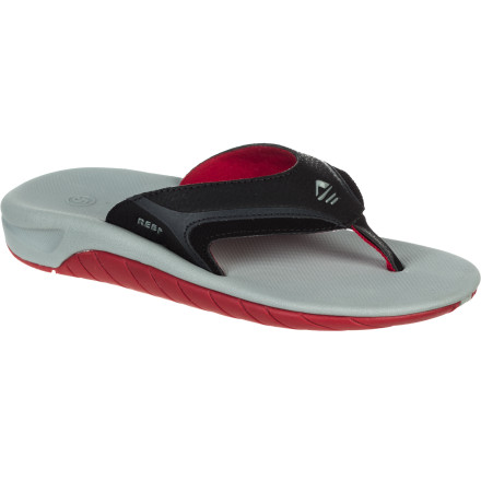 Surf Keep him romping around the beach in comfort this summer in the Reef Slap II Boys' Sandal. It features a cushy EVA footbed for all-day comfort and a stretchy heel strap to provide a secure fit, so he doesn't leave his sandals in the dust every time he takes off on a new adventure. - $25.95