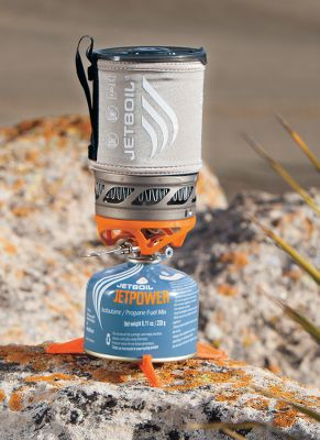 Camp and Hike The ultimate in ultralightweight cooking performance in extreme conditions. The Jetboil Sol Titanium Premium Cooking Systems Thermo-Regulate burner technology delivers consistent heat output down to 20F. Push-button igniter. Includes an 0.8-liter titanium FluxRing cup, burner base, pot support, tripod and insulating cozy. Fuel bottle not included.Dimensions: 4.1H x 6.5W.Weight:8.5 oz. - $149.95