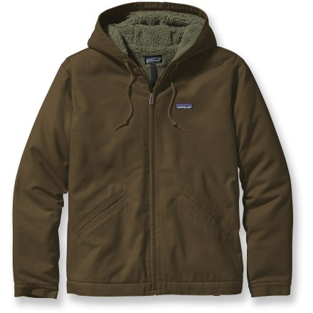 When the going gets tough, the tough take shelter in the Patagonia Lined Canvas hoodie. Durable cotton canvas exterior and plush fleece lining come together to keep you warm on even the coldest days. Organic cotton canvas exterior offers durability and toughness while protecting you from cold and wind; sherpa fleece interior insulates while maintaining breathability. Fleece lining is made up of 70% recycled polyester; sleeves are lined with Thermogreen(R) synthetic insulation that slides easily over inner layers. Generous hood offers additional warmth and adjusts easily with drawcord. Articulated elbows ensure freedom of motion. 2 tricot-lined handwarmer pockets store small items and keep hands safe from wintry weather. Patagonia Lined Canvas hoodie features 1 interior zippered pocket for securing small valuables. Full-length front zipper offers ventilation and easy on and off. Closeout. - $99.93