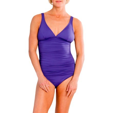 Surf The one-piece Carve Vista swimsuit keeps you comfortable and confident whether you're swimming at the local pool or frolicking in the surf. Soft and stretchy, water-ready fabric provides UPF 50+ sun protection, shielding skin from harmful ultraviolet rays. Vista swimsuit features removable chest pads, gathered fabric at center and deep V-neckline. - $53.93