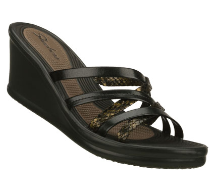Surf Get deeply involved in warm weather style with the SKECHERS Cali Rumblers - Tangled sandal.  Smooth faux leather upper in a wedge heeled strappy slide sandal with print detailing. - $46.00