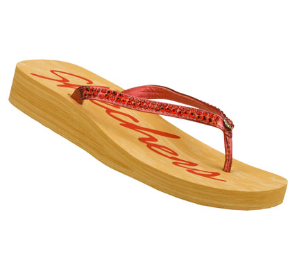 Surf Give your feet pure easygoing style with the SKECHERS Cali Beach Read sandal.  Soft faux suede upper in a slim strap flip flop thong sandal with glittering rhinestones and a low wedge heel. - $32.00