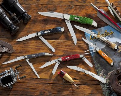 Camp and Hike A splendid collection of seven popular Case knives in various colors. Carry a different high-quality pocketknife each day of the week. The knives come in a handsome walnut display/presentation case. Made in USA. Overall box weight: 64 oz. Set includes: Sunday Mother of Pearl Mini CopperLock with a locking clip blade and Case-embossed bolster. Blade length: 3.5. Overall length: 7.125. Closed length: 3.625. Weight: 2 oz. Monday Golfers Tool sports a clip blade, divot tool and Rogers jigged orange bone handle. Blade length: 2.7. Overall length: 6.2. Closed length: 3.5. Weight: 2.6 oz. Tuesday Stockman with clip, sheeps-foot and spey blades and a Rogers jigged dark red bone handle. Blade length: 3.5. Overall length: 7.375. Closed length: 3.875. Weight: 2.9 oz. Wednesday Fishing knife with a long clip blade and scaler blade. Standard jigged gray bone handle. Blade length: 4. Overall length: 8.25. Closed length: 4.25. Weight: 2.6 oz. Thursday Trapper with clip and spey blades. Rogers jigged Mediterranean blue bone handle. Blade length: 3.5. Overall length: 7.125. Closed length: 4.125. Weight: 4 oz. Friday Folding Hunter outfitted with clip and skinner blades. Bright green Rogers jigged bone handle. Blade length: 5. Overall length: 10.25. Closed length: 5.25. Weight: 7.5 oz. Saturday TrapperLock with a one-hand-opening clip blade and thumb stud. Genuine burnt stag handle. Blade length:3.875. Overall length: 8. Closed length: 4.125. Weight: 3.4 oz. - $799.99