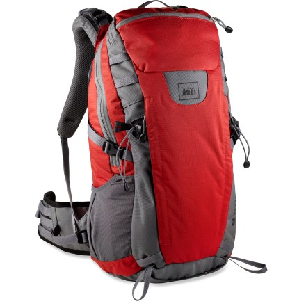 Camp and Hike Choose the REI Traverse 30 daypack for all your day hiking adventures. Largely made from 100% recycled PET polyester fabric, each pack keeps 24 16-oz. plastic bottles out of landfills! Post-consumer recycled PET polyester is tough enough to endure the daily grind. Free-Flow egg crate foam back panel is designed to improve body contact comfort, with channels for air circulation to keep your back cool and dry. Contoured, padded shoulder straps and waistbelt wrap around to offer comfortable support under pack load. Removable high-density polyethylene framesheet supports heavy loads and protects your back from bulky or pointy items. Panel-loading pack has 2 top zippered pockets that allow room for organizing small items such as sunglasses, hat, gloves, ID and keys. Twin vertical zippered front pockets provide storage for important items such as multitool, headlamp and compass. Mesh pocket on waistbelt provides storage for often-accessed essentials; lash points on other side of hipbelt wing provide spot to secure GPS or camera case. Side mesh pocket creates convenient storage and on-the-go access to water bottle, sunscreen, snacks or small electronics. Front of pack features lash points and twin ice axe loops, giving you the option to strap on bulky gear. Side compression straps let you cinch down loads for jostle-free carrying. Built-in rain cover stows in bottom compartment. Internal sleeve accommodates the hydration reservoir of your choice (not included); dual exit ports allow drinking tube to be routed on either side of pack. Special buy. - $65.73