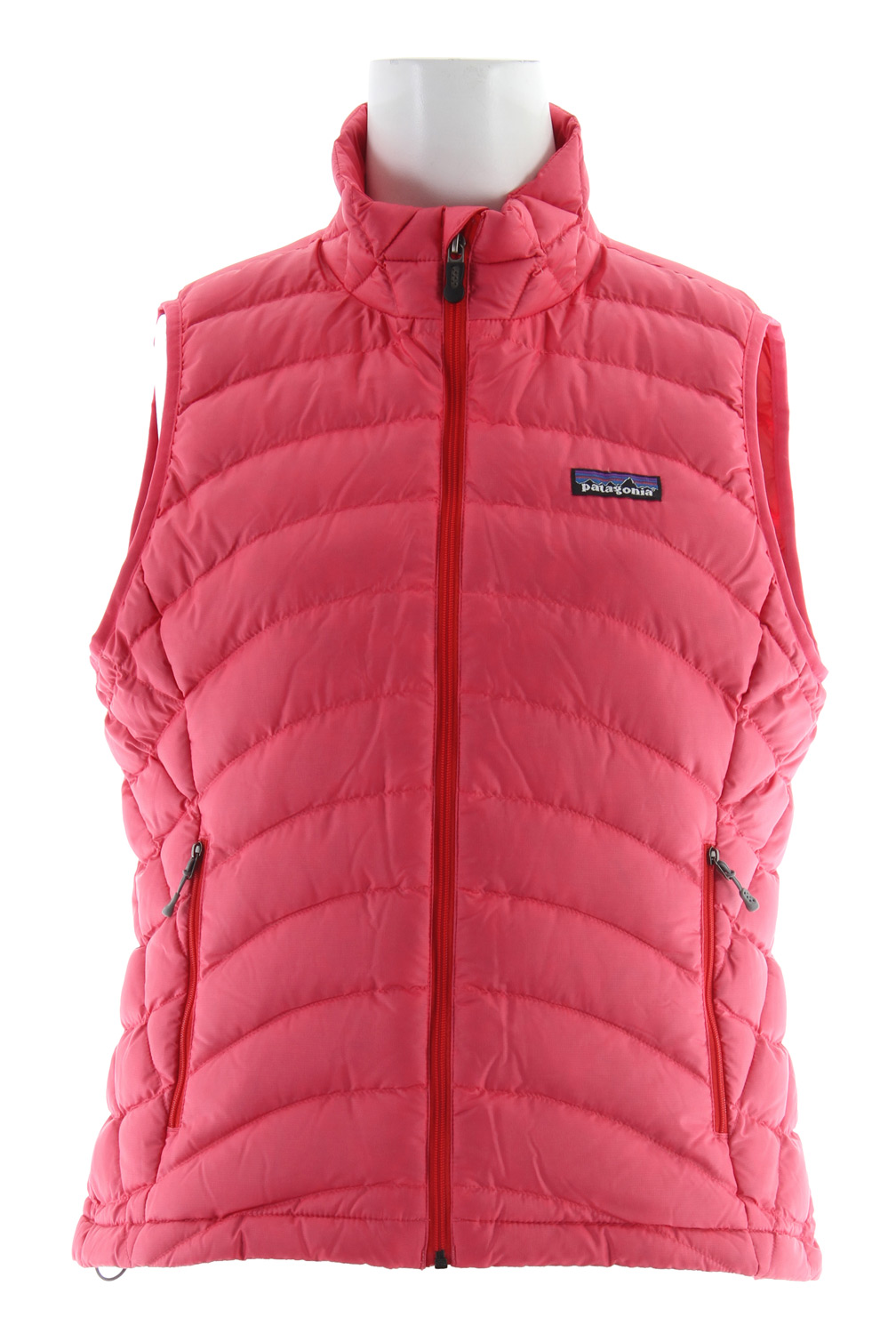 Simple, lightweight core warmth. This vest's minimalist design practically floats, its 800-fill-power down traps heat in alpine conditions, and it's so compact it stuffs into a stretch-mesh internal pocket (with a carabiner clip-in loop). The innovative 100% recycled polyester shell with a Deluge DWR (durable water repellent) finish provides wind and water protection as well as a high tear-strength; quilting stabilizes the down. With zippered handwarmer pockets and a drawcord hem. Recyclable through the Common Threads Recycling Program.Key Features of the Patagonia Down Sweater Vest: Superlight, windproof shell has high tear-strength and is treated with a Deluge DWR (durable water repellent) finish Quilted construction stabilizes the 800-fill-power premium European goose down Pockets: two zippered handwarmers, one zippered stretch-mesh, which doubles as a stuff sack and has a carabiner clip-in loop Elastic binding at armholes Drawcord hem Shell and lining: 1.4-oz 22-denier 100% recycled polyester with a Deluge DWR (durable water repellent) finish. Insulation: 800-fill-power premium European goose down. Recyclable through the Common Threads Recycling Program 235 g (8.3 oz) Made in China. Recycled Polyester: We recycle used soda bottles, unusable second quality fabrics and worn out garments into polyester fibers to produce many of our clothes. Deluge DWR: Patagonia's proprietary durable water repellent fabric finish, Deluge DWR, lasts substantially longer than standard DWRs. Garments with the Deluge DWR finish have like-new repellency after years of extensive use. - $112.95