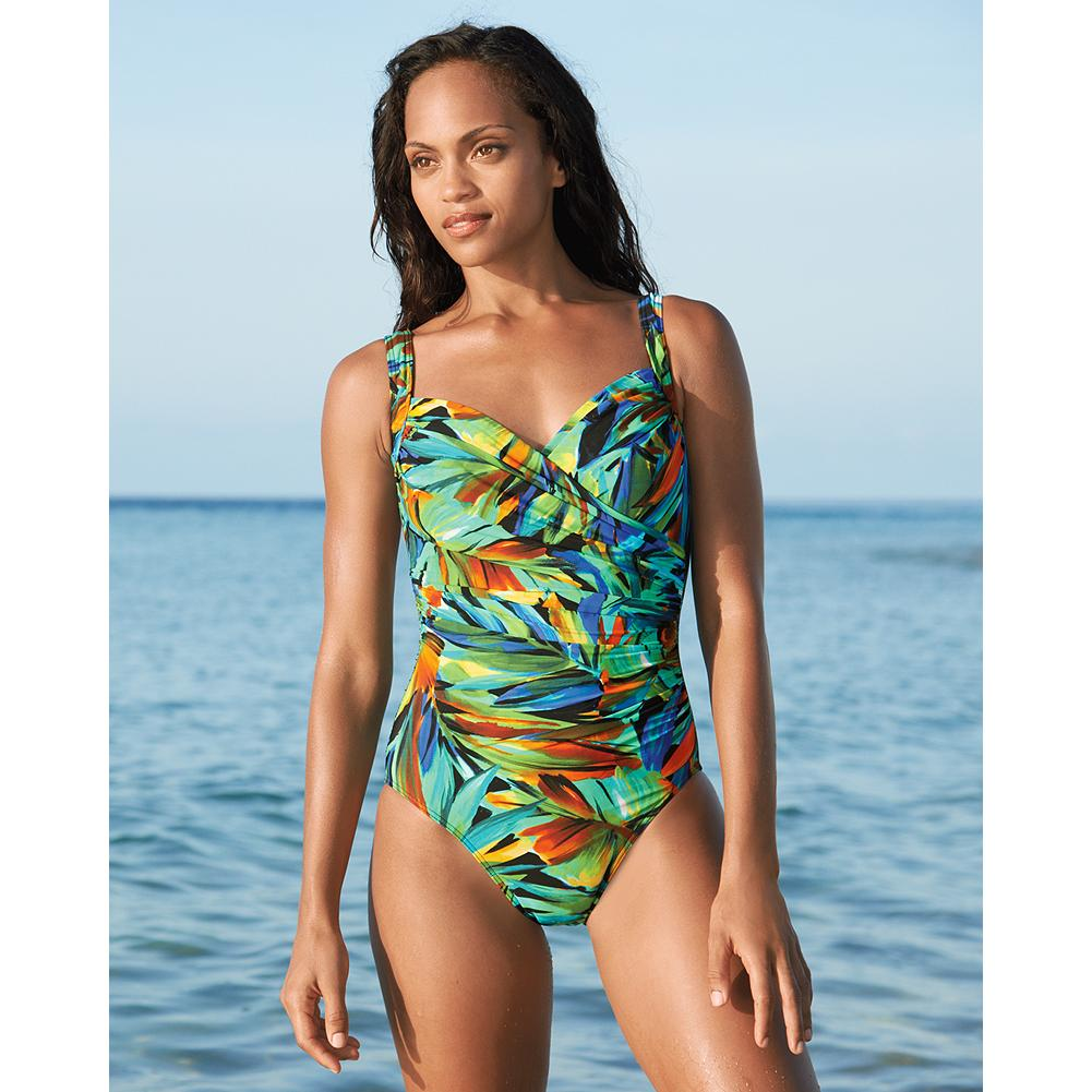 Wake Miraclesuit Sanibel One-Piece Swimsuit - Multi Print - Look 10 pounds lighter in 10 seconds in this Miraclesuit one-piece swimsuit. Revolutionary Miratex fabric is made with three times the amount of spandex you'll find in other suits, so it provides incredible shaping, firming and holding power without any uncomfortable panels. The Sanibel one-piece swimsuit has a flattering faux-wrap silhouette with a hidden underwire bra. - $39.99
