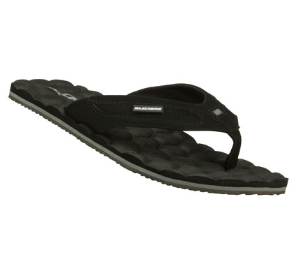 Surf Score some comfortable laid-back style with the SKECHERS Goals - Deven sandal.  Smooth faux leather upper in a flip flop casual thong sandal with stitching and perforation accents.  Textured comfort footbed. - $29.00