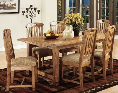 Entertainment Gather friends and family alike around this beautiful solid-oak and veneer table with a rustic, mission-style finish. Two included leaves (12 each) can be easily inserted to accommodate a bigger guest list. Pedestal legs. Chairs sold separately. 30H x 95W x 42D. - $1,105.99