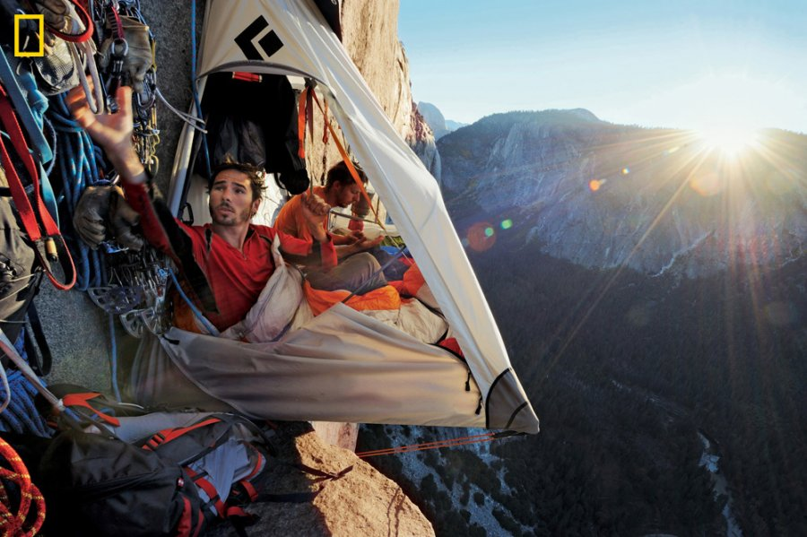 "Climbing Kevin Jorgeson (left) and Tommy Caldwell live in a ""portaledge"" 1,500 feet above the valley for up to two weeks when working on a route. Amenities include a French press for coffee and iPhones charged with a solar panel."