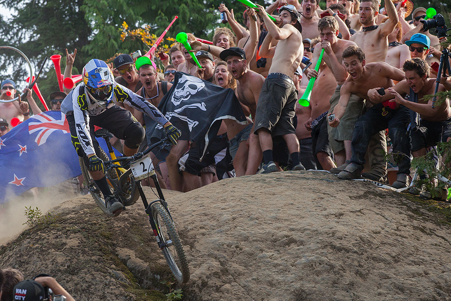 "MTB Crankworx Festival winner Steve Smith crosses over ""hecklers rock"" on his way to the finish"