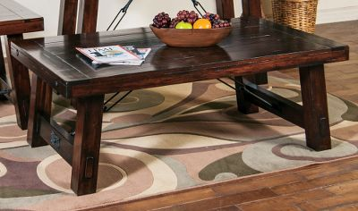 Entertainment The Vineyard Coffee Table is constructed of a solid-wood top, distressed mahogany solids and distressed industrial turnbuckle accents for a clean, rustic look. Strong tongue-and-groove construction. Durable 12-step finish process. Imported. Dimensions: 52L x 30D x 19H. Color: Mahogany. - $420.99