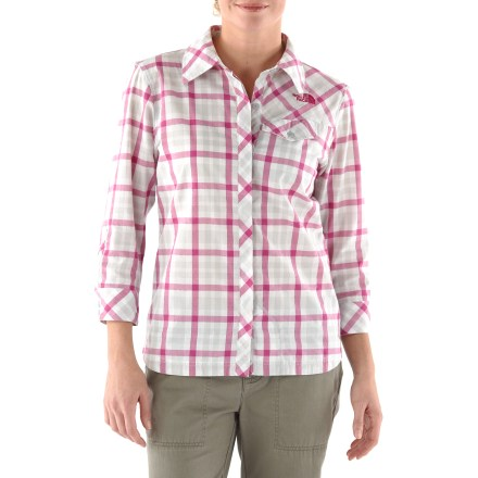 MTB The North Face Brushcut women's button-up bike shirt may appear to be a casual, everyday top, but it's full of riding-friendly features with reflective yarns, sweat-wicking fabric and UPF protection. Shirt is made from a cotton/polyester fabric blend that's comfortable against skin and draws moisture away from your body for quick evaporation. 3M(TM) reflective yarns woven throughout the fabric and reflective logos increase your visibility to motorists. With a UPF 15 rating, fabric provides good protection against harmful ultraviolet rays. Buttoned front chest pocket with cord port and buttoned rear pocket help secure small riding essentials. A handy sunglasses chamois wipe is sewn into underside of the front of The North Face Brushcut bike shirt. - $51.93