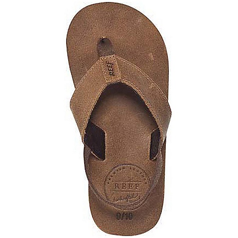 Surf Reef Boy's Grom Leather Smoothy Sandal DECENT FEATURES of the Reef Boys' Grom Leather Smoothy Sandal Premium leather upper with branded logo on the heel Polyester web toe post Suede footbed over Reef-Flex triple density EVA construction with anatomically correct arch support First 4 sizes: 3/4, 5/6, 7/8, 9/10 come with an optical synthetic back strap Durable, high density EVA outsole - $34.95