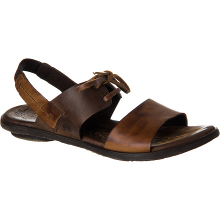 Surf The Born Women's Algeria Sandal blends the smooth, natural look of full-grain leather with simple, wide straps and a sensible, thin heel-strap, and then adds a slim bow on top for personality. Enjoy this high-quality sandal year after year. - $94.95