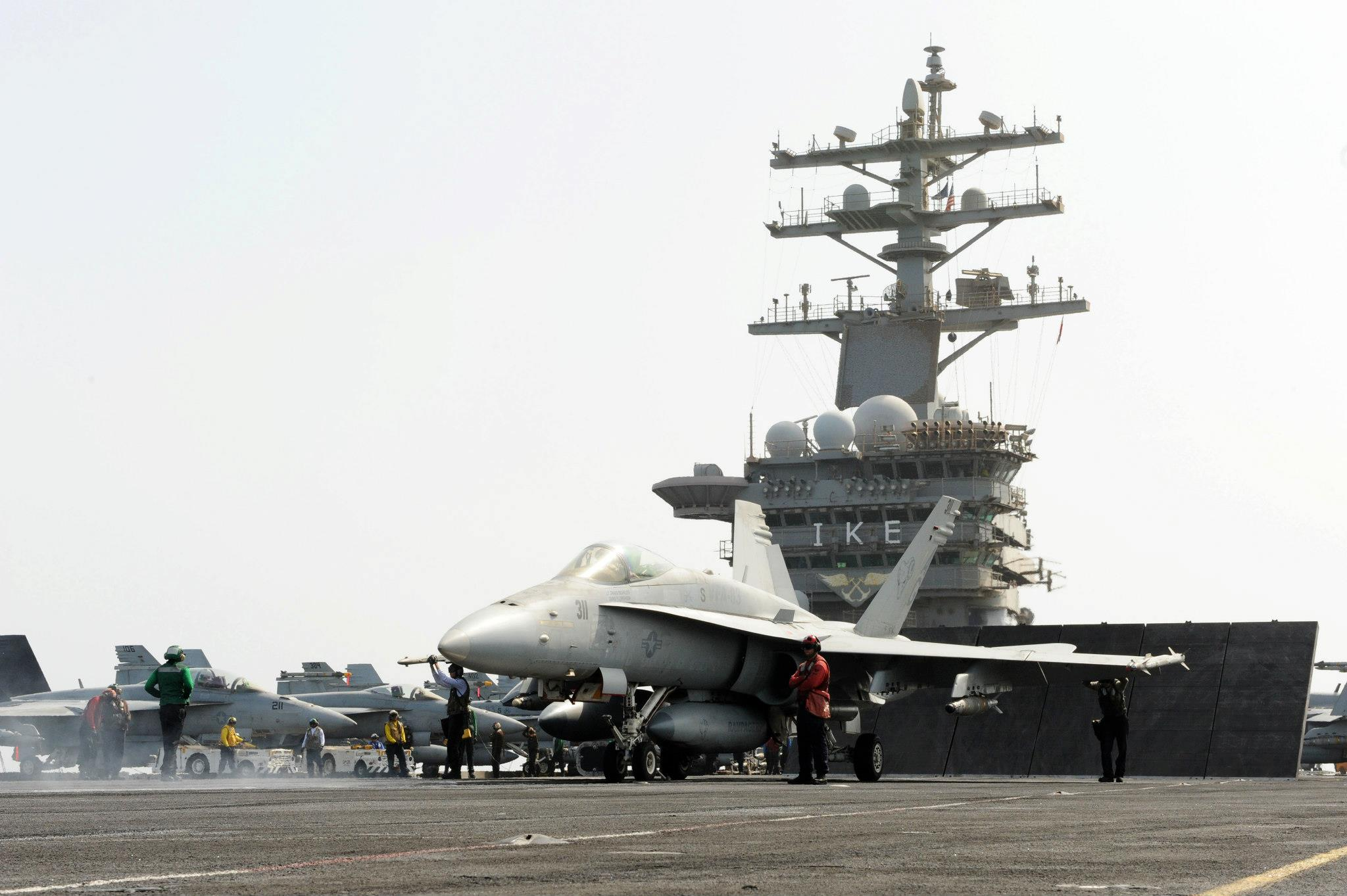 Guns and Military ARABIAN SEA (Aug. 20, 2012) An F/A-18C Hornet assigned to the Rampagers of Strike Fighter Squadron (VFA) 83 prepares to launch during a launch cycle aboard the Nimitz-class aircraft carrier USS Dwight D. Eisenhower (CVN 69).